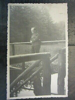 Original WWII German Soldier Poses Against Rail Fence Photo