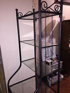 Tall, metal display shelf