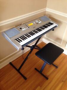Yamaha digital piano keyboard with bench, stand, cover, adapter