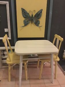 2 yellow kids chairs with dining table - available