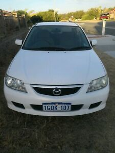 SOLD PENDING PICKUP - 2003 Mazda 323