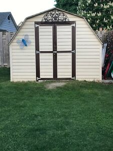 Solid wood shed with siding.