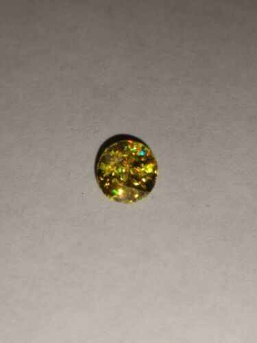 1.12ct. Multi-color sphene