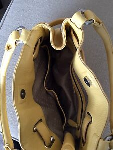 Cole Haan yellow leather purse in pristine condition