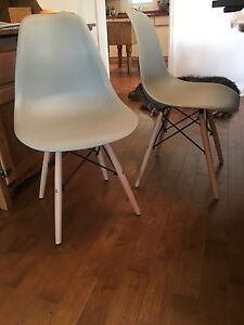 Four light grey Eames style dining chairs