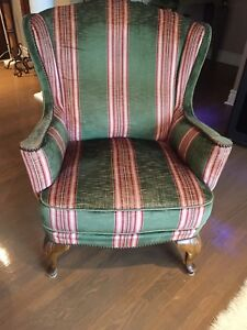 Antique Claw Foot Wing Back Chair with extensive nailhead trim
