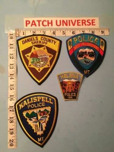 LOT OF FOUR  DIFFERENT MONTANA  SHOULDER  PATCHES  O030