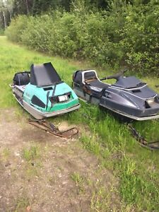 3 old sleds