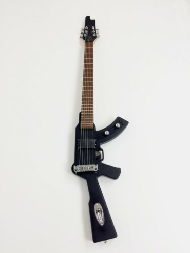 Haze HD500BK Gun-Shaped Electric Guitar, Speckle Finish,LED Lights on Fretboard