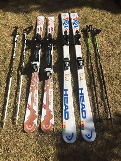 2 Pairs of skis with poles & bag