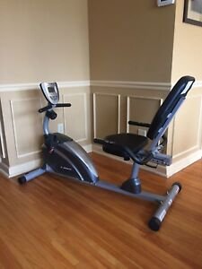 Recumbent exercise bike, digital display, in excellent shape