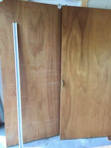 Sliding closet doors with guide track.