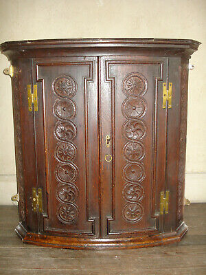 SMALL EARLY 18TH C CARVED OAK CORNER CUPBOARD