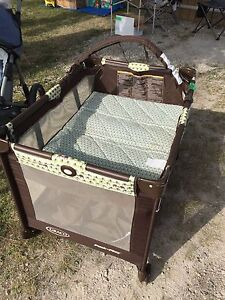 Play pen with with bassinet top.
