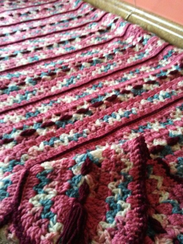 handmade crocheted afghan done in ombre