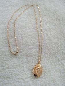 9ct gold locket and  22 inch chain marked 375
