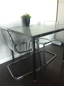 Glass top table with 2 clear chairs