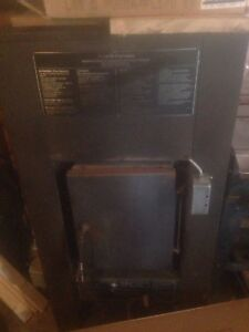 Forced air wood burning furnace