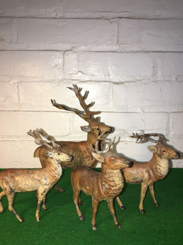 VINTAGE REINDEER SET OF 4 LARGE DEER 7 INCHES HIGH SMALL 5 MADE IN GERMANY  LEAD