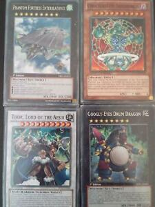 4 high level Yu-Gi-Oh! Cards, protector on all.