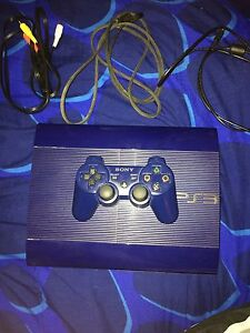PS3 SLIM WITH GAMES AND HEADSET
