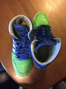 Selling green adidas shoes