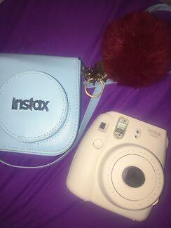 White Instax Polaroid Camera
