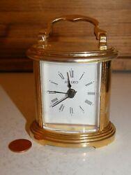 preowned SEIKO battery ALARM Clock desk clock in Brass case model QHE109G