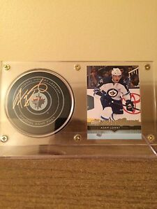 Winnipeg Jets signed pucks w/ rookie card