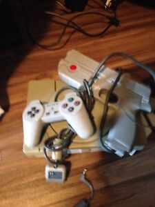 Sony 1 with gun and controller and 5 games