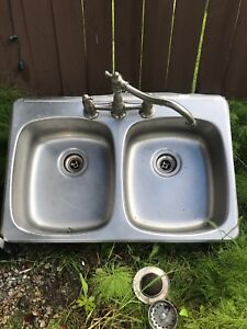 Stainless sink and faucet