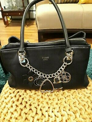 BLACK LEATHER GUESS HAND BAG WITH FRONT CHAIN AND CHARMS