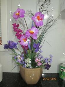 HEAPS OF. FLOWER ARRANGMENTS in vases