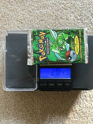 FACTORY SEALED POKEMON FIRST EDITION JUNGLE SCYTHER PACK SHORT CRIMP, 20.49 GMS.