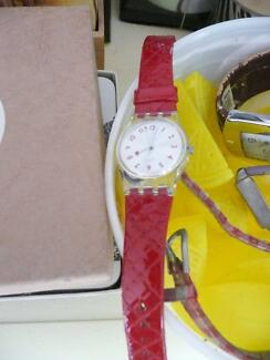swatch watch with red band