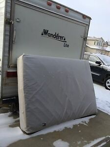 Free double mattress with cover.
