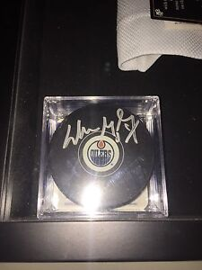 Hand Signed Hockey Pucks In Cases