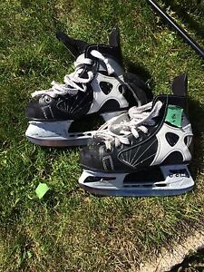 Assorted skates and hockey equipment