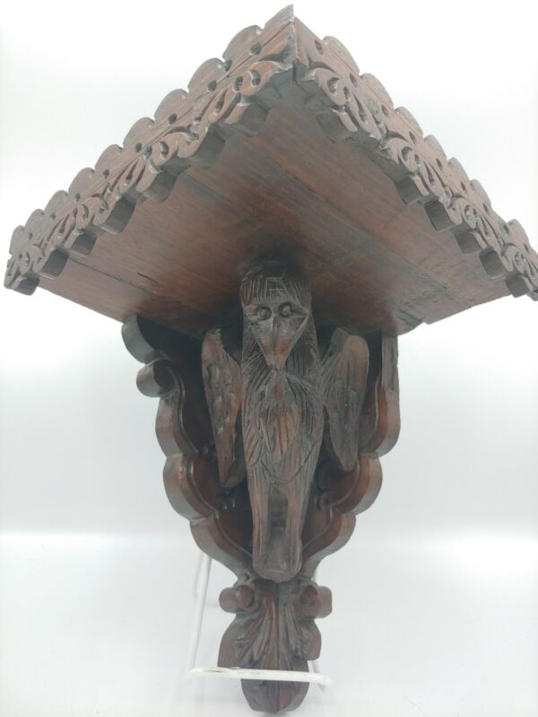 Antique hand carved eagle corner wooden shelf. Beautifully detailed wood