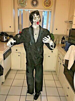 Halloween prop GEMMY ANIMATED LIFESIZE ZOMBIE. HEAD TURNS, lights, sounds.