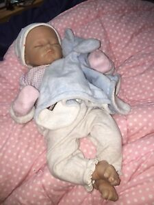 Reborn baby doll with silicone arms, legs and belly