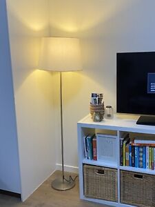 Floor lamp with cream coloured shade