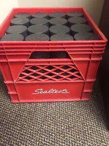 Crate of used hockey pucks