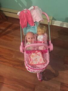 Baby carriage with babies and extra clothes