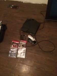 PS3 two controllers and games London Ontario image 9