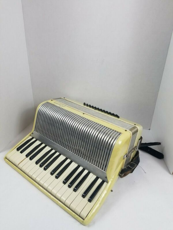 Vintage Rossivi accordion. Made in Italy. White Pearl. Musical instrument.