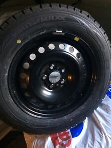 Brand new snow tires and rims 215/60/16