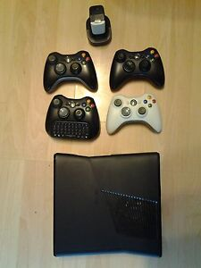 xbox 360. 4 controllers, charger for controllers. and 20 games