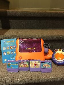 Vtech Smile console and 4 games