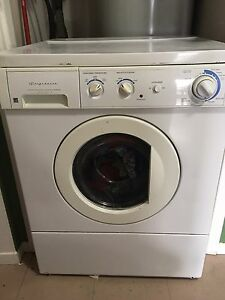 Front load washer stackable with dryer